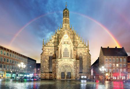 Nuremberg, cathedral Frauenkirche in Hauptmarkt wtih rainbow, Bavaria, Germany