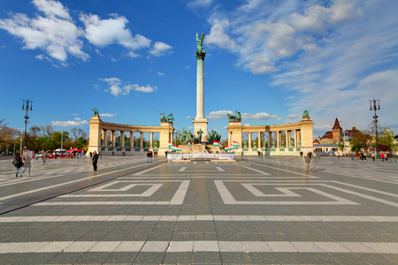 heros: BUDAPEST - APRIL 18 2015: Tourists visit Millennium Monument in Heroes Square in Budapest, Hungary. This square has been UNESCO World Heritage site since 2002.