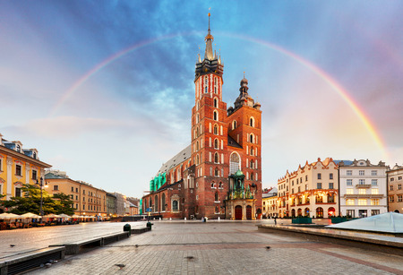 St. Marys basilica in main square of Krakow with rainbow