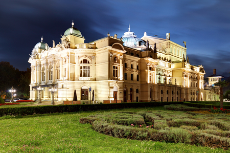 eclecticism: Juliusz Slowacki Theatre by night in Krakow, Poland, Eclectic style 19th century architecture. Stock Photo
