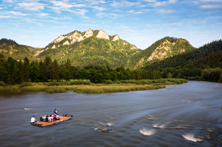 Rafting on the polish river on a Three Crowns background 스톡 콘텐츠
