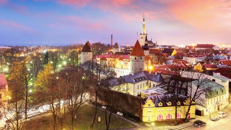 Aerial view of Tallinn Medieval Old Town with St. Olafs Church and Tallinn City Wall. Tallinn, Estonia Фото со стока