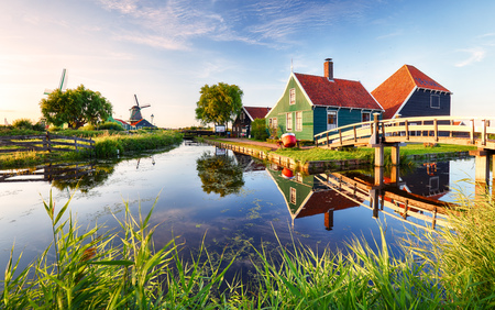 holland windmill: Traditional dutch windmill near the canal. Netherlands, Landcape at sunset