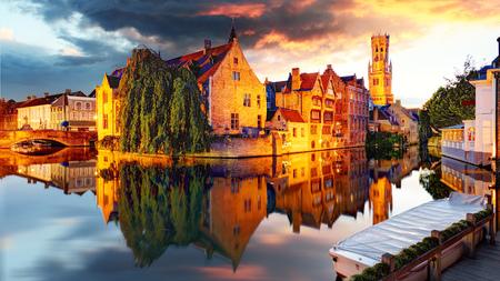 Belgium - Bruges,  Rozenhoedkaai with Perez de Malvenda house and Belfort van Brugge at sunset Stock Photo