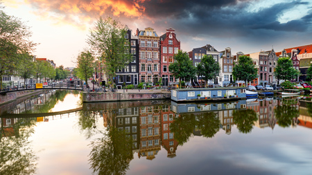 Amsterdam Canal houses at sunset reflections, Netherlands