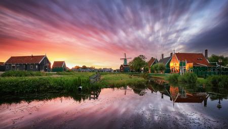 Dutch landscape with windmill at dramatic sunset, Zaandam, Amsterdam, Netherlands Reklamní fotografie
