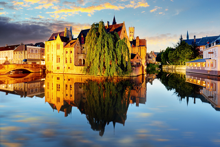 Canal in Bruges and famous Belfry tower on the background at sunset, night, Belgium Reklamní fotografie