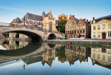 Gent - Medieval cathedral and bridge over a canal in Ghent, Belgium Reklamní fotografie