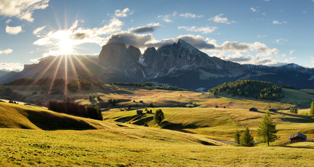 Beautiful Scenery from Alpe di Siusi, Italy in summer sunrise light with small wooden cottage and sharp mountains of dolomite. Seiser Alm with Langkofel Group South Tyrol, Italy Reklamní fotografie