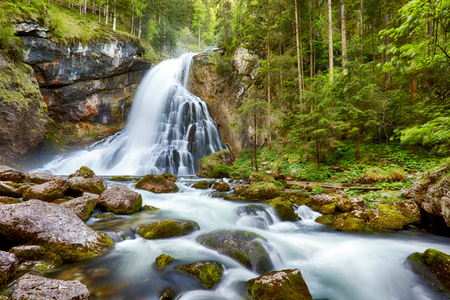 Waterfall with mossy rocks in Golling, Austria