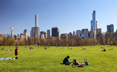 NEW YORK - APRIL 14: Views of the from the big meadow Central Park to Midtown New York on April 14, 2016. The Central Park is a famous Park in the centre of Manhattan, New York.