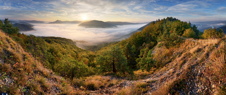 Autumn sunrise above mist and forest landscape, Slovakia, Nosice