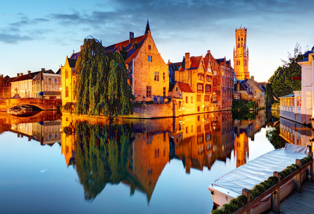 Belgium - Historical centre of  Bruges river view. Old Brugge buildings reflecting in water canal. Reklamní fotografie