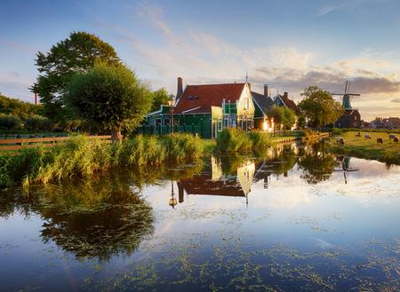 Netherlands windmills at sunset, landscape.