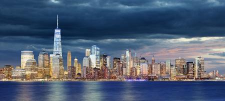 New York City Manhattan downtown skyline at night with skyscrapers lit over Hudson River Reklamní fotografie