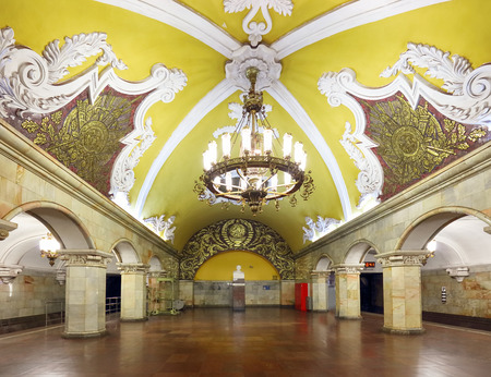 MOSCOW - AUGUST 8, 2018: Train at the metro station Komsomolskaya at night in Moscow, Russia. Komsomolskaya subway is a great example of the Soviet design. Luxurious underground landmark of Moscow.