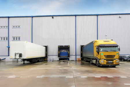 Loading docks in warehouse with truck