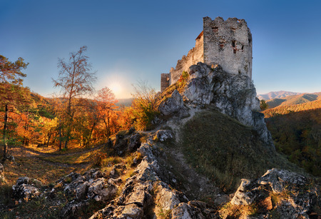 Beautiful Slovakia landscape at autumn with Uhrovec castle ruins at sunset Redakční