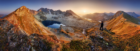 Beautiful dramatic sunset in the mountains. Landscape with sun, Slovakia Tatras panorama