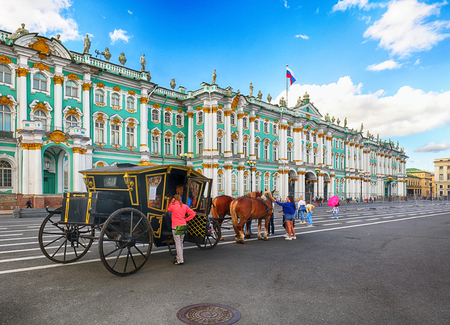 SAINT PETERSBURG, RUSSIA - AUGUST 15, 2018: Beautiful carriage with a horse standing on Palace square among the many tourists in Saint Petersburg, Russia
