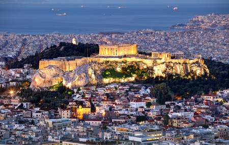 Athens skyline panorama with Acropolis in Greece from peak Lycabettus at night Reklamní fotografie