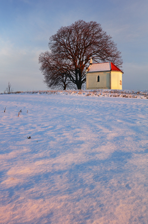 Winter with snow in the countryside with chapel, Slovakia Reklamní fotografie