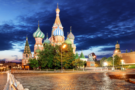 St. Basils Cathedral in Moscow on Red Square on a summer evening and a blue cloud