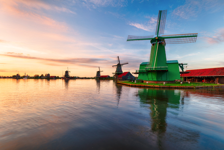 Dutch landscape with windmill at dramatic sunset, Zaandam, Amsterdam, Netherlands 写真素材