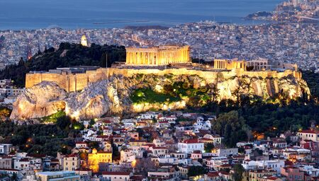 Athens skyline panorama with Acropolis in Greece from peak Lycabettus at night 写真素材