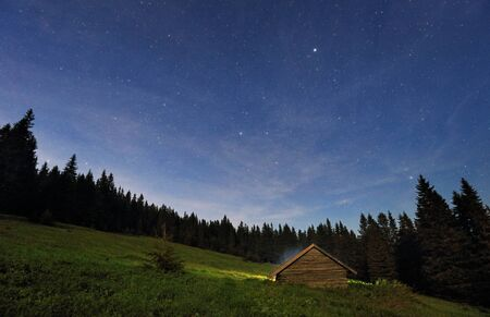 Night view of mountain stars with cottage