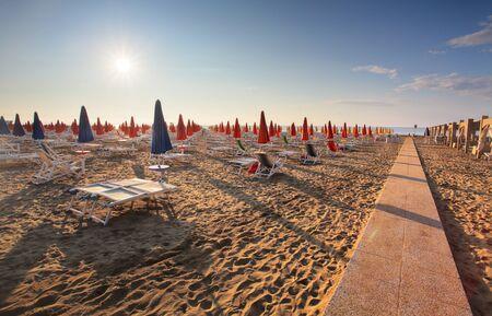 Amazing Sunrise On the Sea. Adriatic sea with shore. Lignano Sabbiadoro, Italy.