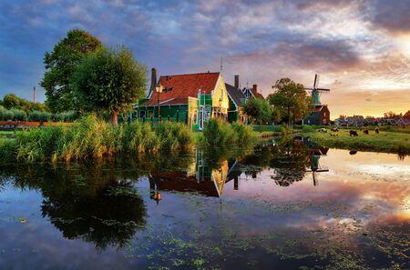 Dutch landscape with windmill at dramatic sunset, Zaandam, Amsterdam, Netherlands Stok Fotoğraf