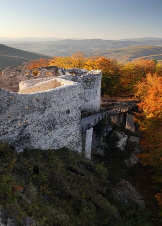 Slovakia - ruin of castle Uhrovec at nice autumn sunset landscape