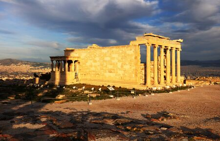 Erechtheion temple in Athens during the sunrise. Ruins of the Temple of Erechtheion and Temple of Athene at the Acropolis hill in Greece Stok Fotoğraf