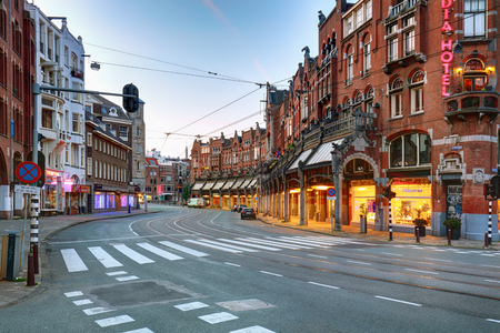Amsterdam-Netherlands, August 18, 2017 : Street scene with modern tram in Amsterdam, tram is one of the quickest ways to get into and around the city centre
