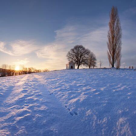 Winter with snow in the countryside with chapel, Slovakia Stok Fotoğraf