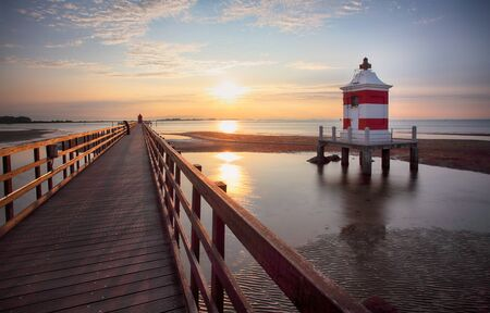 Italy beach - Lignano Sabbiadoro Lighthouse with beach at sunrise