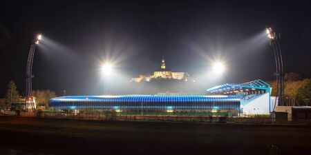 Nitra skyline at nigth with castle, church and football stadion
