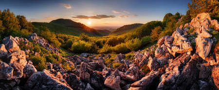 Panorama of rocky mountain at sunset, nice landscape