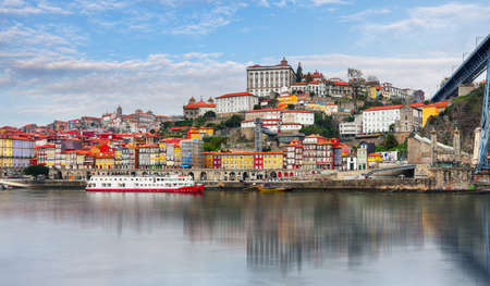 Porto day with reflection in Douro river. Portugal