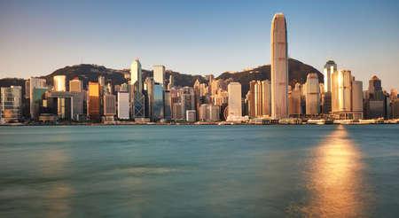 Victoria Harbor at sunset view in Hong Kong, China Фото со стока