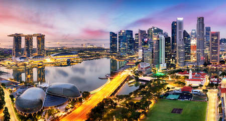 Skyscrapers of Singapore skyline at the beautiful sunset, aerial panorama