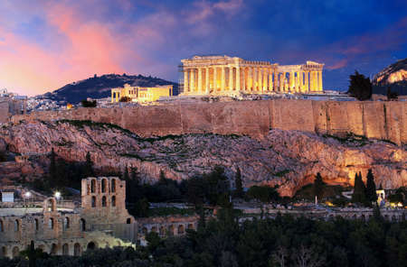 Acropolis of Athens, Greece, with the Parthenon Temple during sunset Редакционное