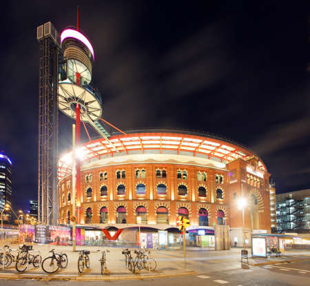 Old Arena building in Barcelona, Catalonia, Spain at night Редакционное