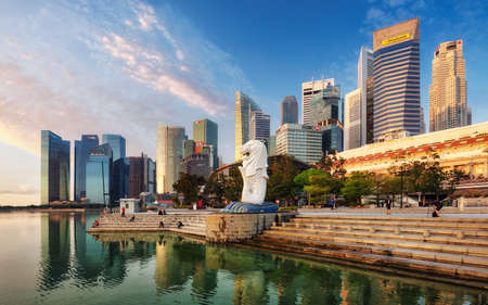 SINGAPORE - OCTOBER 11: Singapore - Merlion fountain in front of the Marina Bay Sands hotel at sunrise