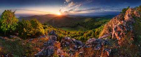 Panoramic view of idyllic mountain scenery in the Carpathian with fresh green forest in springtime.