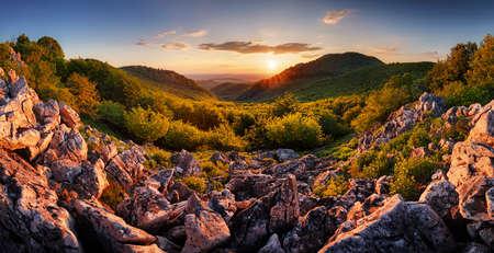 Beautiful sunrise in mountains with sun - panorama Фото со стока