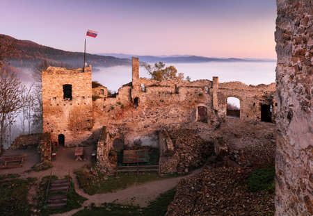 Slovakia castle at sunrise with mist - Ruin of Povazsky hrad