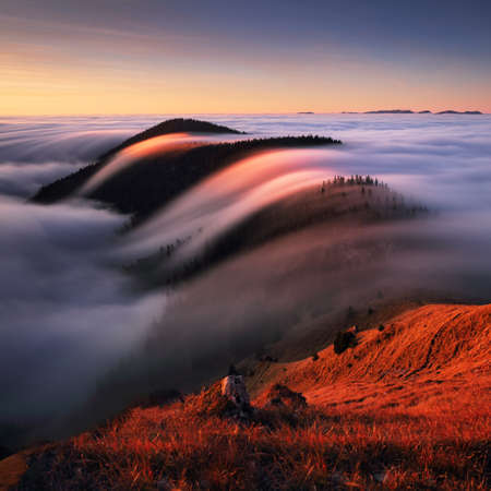 Autumn landscape, beautiful sunrise above the heavy clouds, Mountain sea