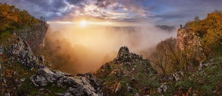 Dramatic sunrise in mountains with fog, sun and silhouette of man - landcape panorama Reklamní fotografie - 164323190
